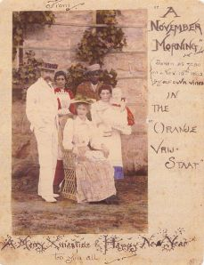 Handwritten Christmas card with a coloured photo of the Tolkien family, sent by Mabel Tolkien from the Orange Free State to her relatives in Birmingham, on November 15, 1892.