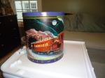 My childhood Lego stuff has been languishing hidden in this old popcorn tin.