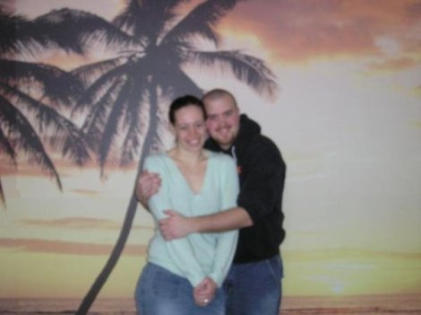 Here we are hugging just prior to getting married. No, we didn't go anywhere exotic in our dating life. That tropical scene was the wallpaper in my apartment prior to us getting hitched.